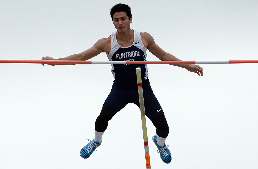 Description of . Flintridge Prep's Barrett Weiss competes in the pole vault during the CIF Southern Section track and final Championships at Cerritos College in Norwalk, Calif., on Saturday, May 24, 2014. 