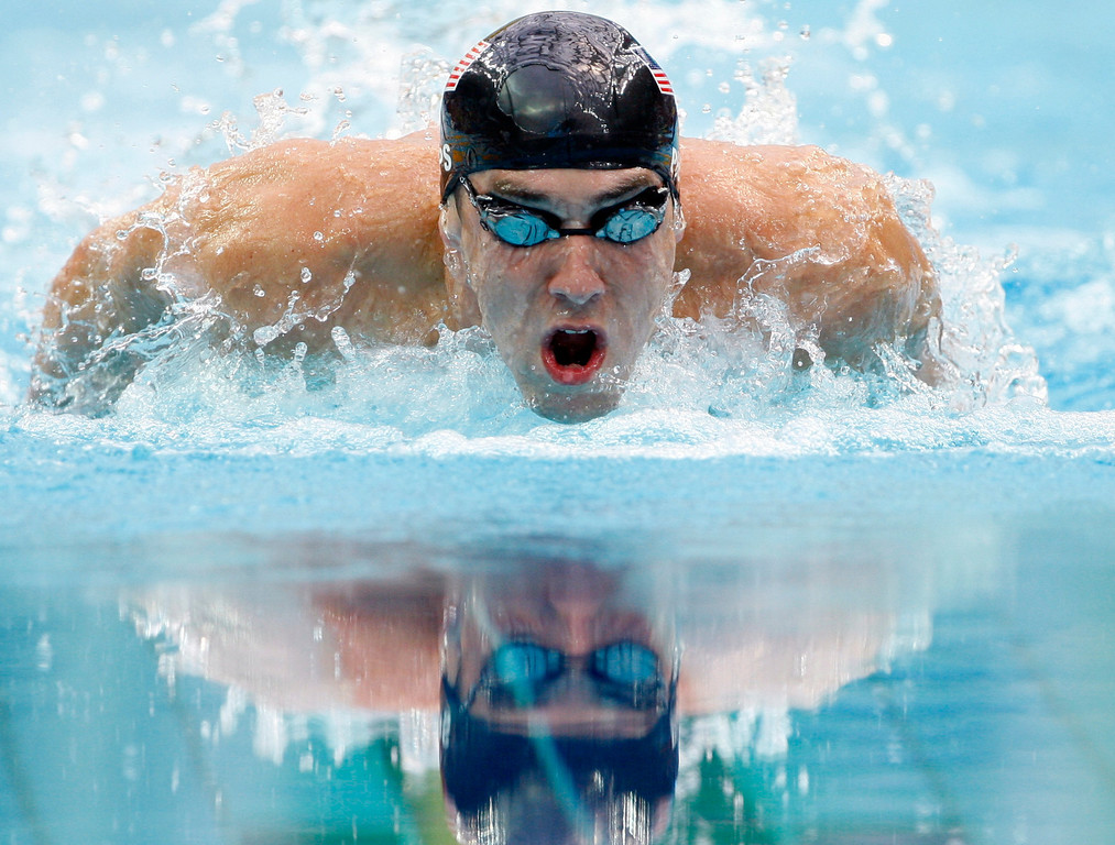 Description of . Michael Phelps of the United States on his way to winning the gold medal in the men's 200-meter individual medley during the swimming competitions in the National Aquatics Center at the Beijing 2008 Olympics in Beijing, Friday, Aug. 15, 2008. (AP Photo/Mark Baker)