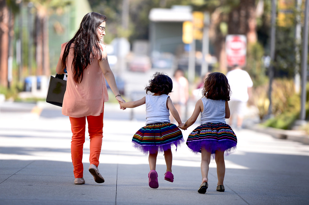 Description of . Mayra Sosa, of Whittier, and her children Alicia 4, and Valentina, 3, leave Rio Hondo College's Latino Heritage Month's kickoff celebration Saturday, September 14, 2013. (Photo by Sarah Reingewirtz/Pasadena Star-News)
