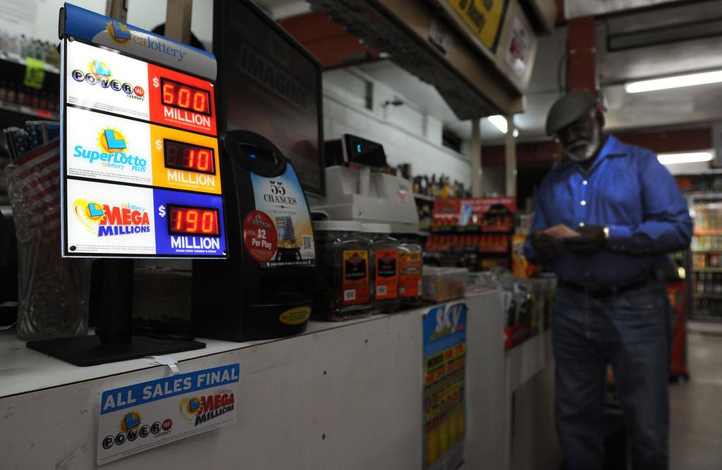 Description of . (John Valenzuela/Staff Photographer)  Adolphus Fulcher of San Bernardino looks over is Powerball numbers at Brookside Market in Redlands, Fulcher said