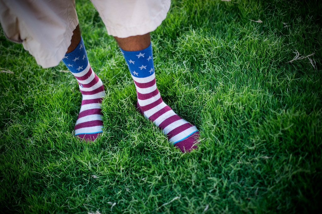 Description of . Chase Thomas, of Los Angeles, wears patriotic socks as he waits for Americafest's annual fireworks show at the Rose Bowl in Pasadena Friday night, July 4, 2014. (Photo by Sarah Reingewirtz/Pasadena Star-News)