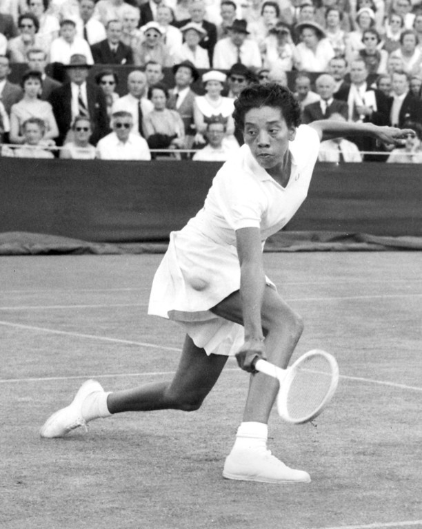 Description of . American athlete Althea Gibson returns to Germany\'s Edda Buding in the first round of Wimbledon on June 26, 1956.  (AP Photo)