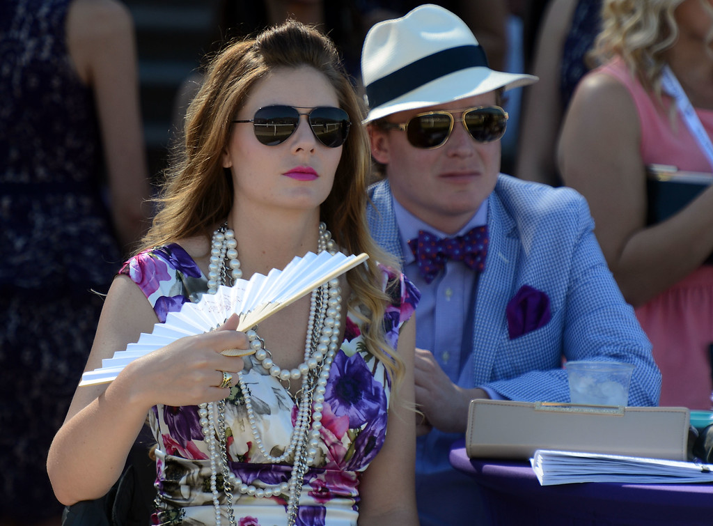 Description of . Fans watch the fourth race during the Breeders' Cup at Santa Anita Park in Arcadia, Calif., on Saturday, Nov. 2, 2013.    (Keith Birmingham Pasadena Star-News)