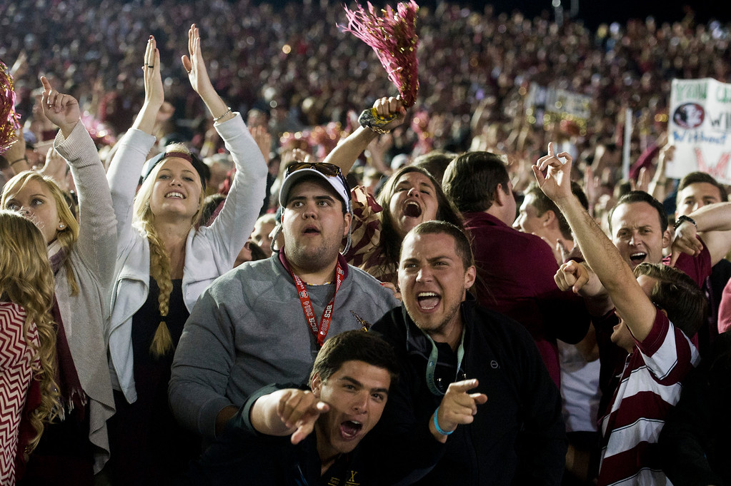 Description of . Florida State fans celebrate their victory over Auburn in the BCS National Championship game at the Rose Bowl in Pasadena Calif. on Monday, Jan. 6, 2014. (Watchara Phomicinda/ Pasadena Star-News)