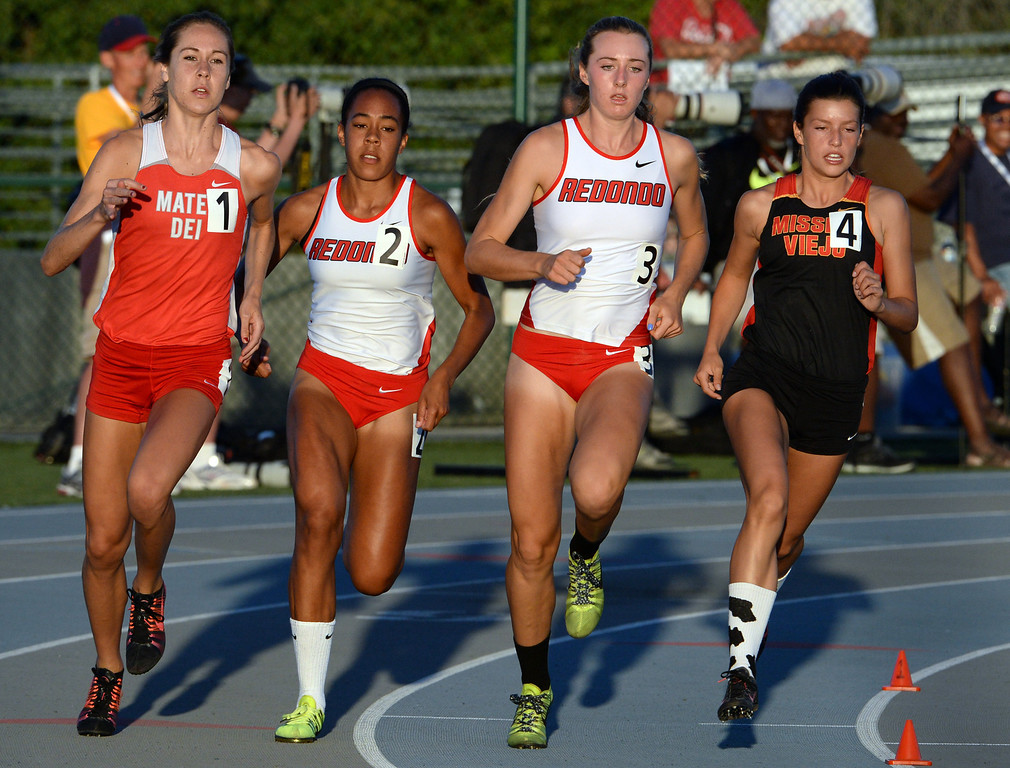 Description of . Mater Dei's Ashlyn Rambo, left, Redondo Union's Amber Gore (2) and Anevay Hiehle along with Mission Viejo's Taylor Arco competes in the 800 meter run during the CIF-SS Masters Track and Field meet at Falcon Field on the campus of Cerritos College in Norwalk, Calif., on Friday, May 30, 2014.   (Keith Birmingham/Pasadena Star-News)