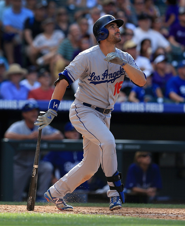 Description of . Andre Ethier #16 of the Los Angeles Dodgers watches his two run home run against the Colorado Rockies at Coors Field on September 2, 2013 in Denver, Colorado. The Dodgers defeated the Rockies 10-8.  (Photo by Doug Pensinger/Getty Images)
