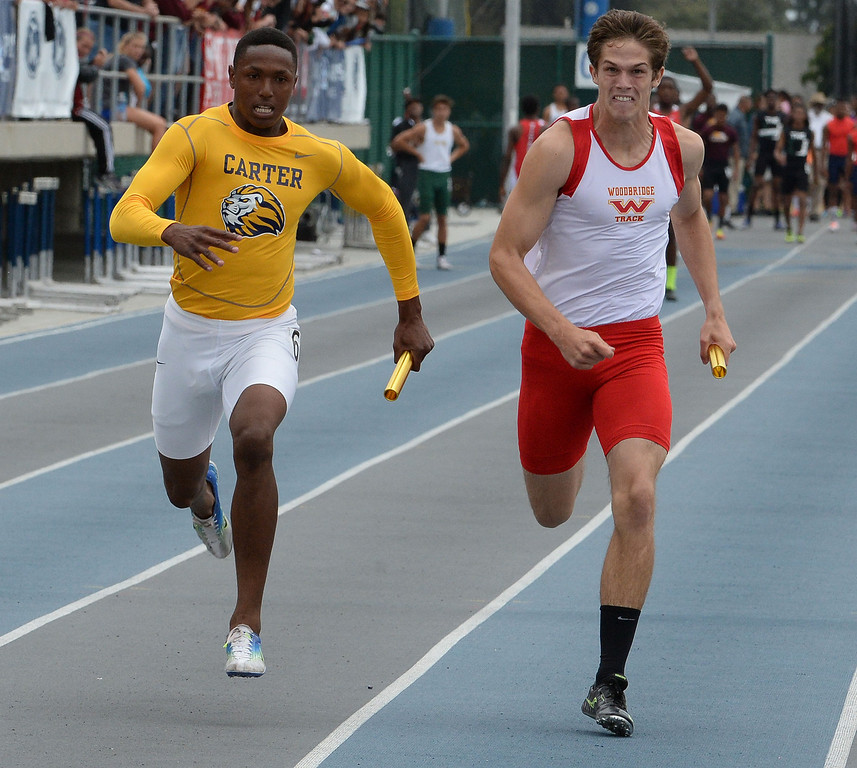 Description of . Carter wins the division 2 4x100 meter race as Paraclete won the race during the CIF Southern Section track and final Championships at Cerritos College in Norwalk, Calif., Saturday, May 24, 2014. 