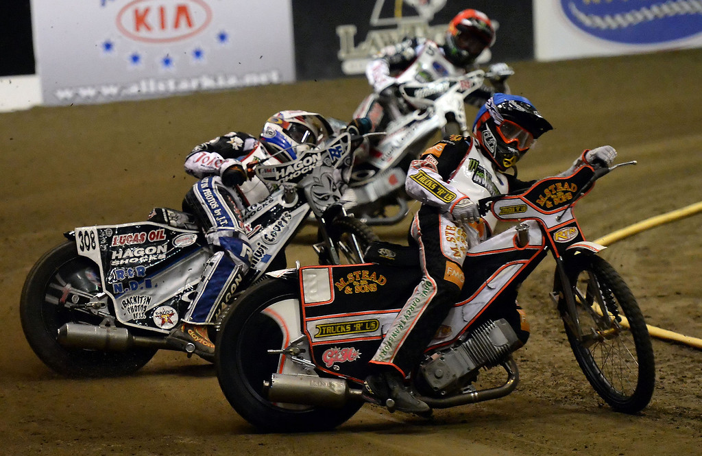 Description of . Scott Nicholls (7), Max Ruml (6) and Gino Manzares (5) in the second race during the Monster Energy Speedway Cycles at the Industry Speedway in the Industry Hills Grand Arena in Industry, Calif., on Saturday, Dec. 28, 2013.     (Keith Birmingham Pasadena Star-News)