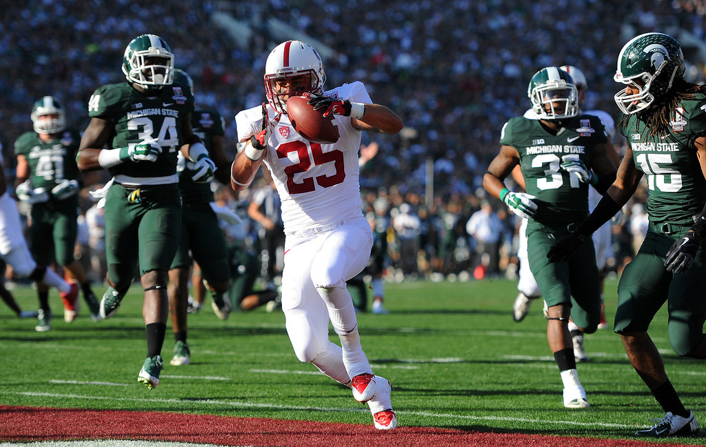 Description of . Stanford RB Tyler Gaffney goes in for a 16-yard touchdown in the first quarter against Michigan State at the Rose Bowl, Wednesday, January 1, 2014. (Photo by Michael Owen Baker/L.A. Daily News)
