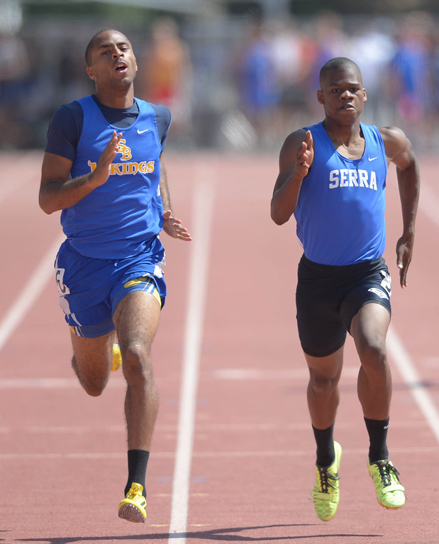 Description of . St. Bernard's Daniel Mouton and Serra's Ronny Hall are stride for stride in the 400 meter Division 4 race of the CIF Southern Section Track and Field Championships Saturday at Mt. SAC. Mouton would win at the line. 20130518 Photo by Steve McCrank / Staff Photographer