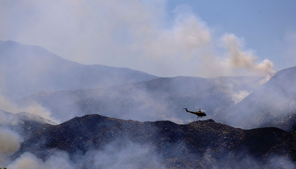 Description of . A Sky Crane  make a drop on the Silver Fire as seen from W. Lincoln Street as  it burns in the mountains south of Banning August 8, 2013.   GABRIEL LUIS ACOSTA/STAFF PHOTOGRAPHER.