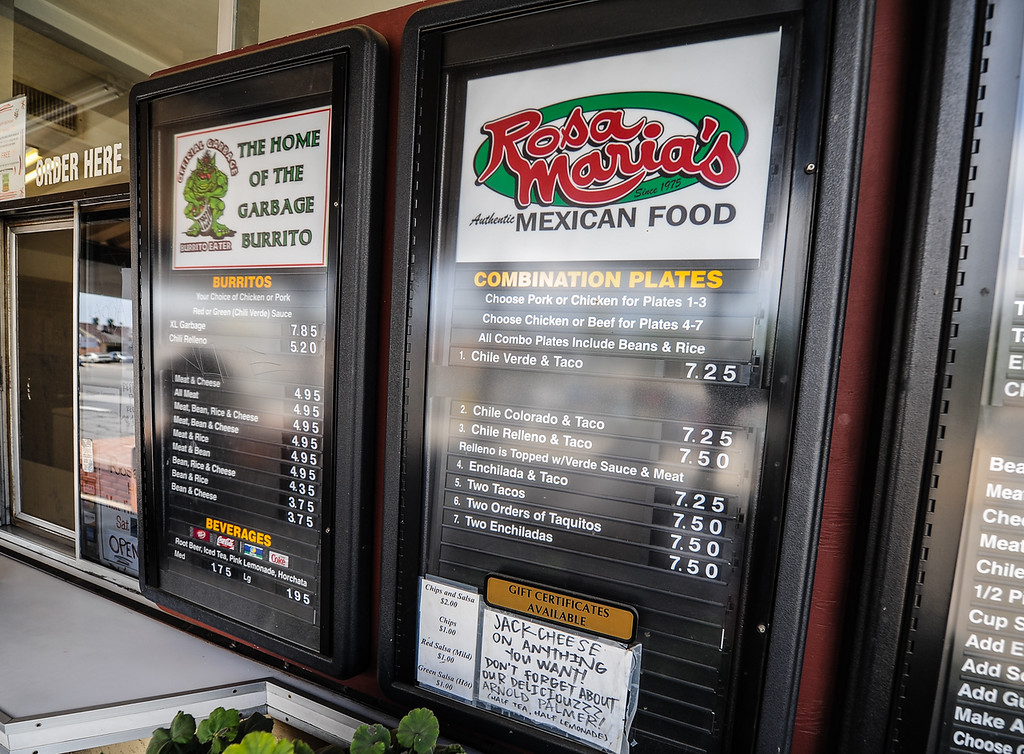 Description of . Mexican food menu is displayed at Rosa Maria's in San Bernardino Wednesday, Sept. 4, 2013. Rosa Maria's is known for its exclusive Garbage Burrito menu item. (Photo by Rachel Luna / San Bernardino Sun)