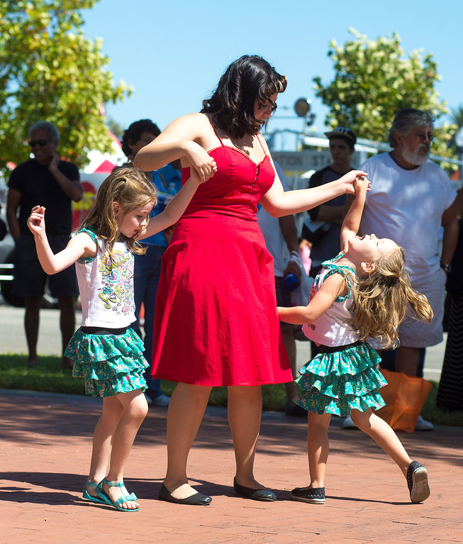 Description of . IDB-L-DBROUTE66-SUN-09 Siblings Apple Safford, 6, Arlie Safford and Amber Miceli, dance to the music, on the last day of the  Route 66 Cruisin' Reunion, on Sunday, September 22, 2013. (photos by Frank Perez for the Daily Bulletin)