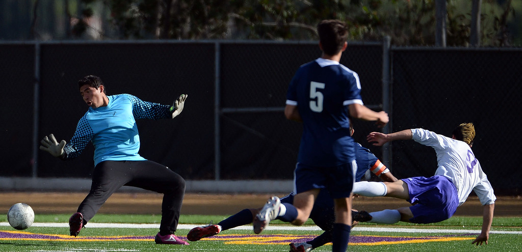 Description of . Diamond Bar's Guy Horcasitas (8) scores past Baldwin Park goal keeper Joshua Luna in the first half of a CIF-SS quarterfinal prep playoff soccer match at Diamond Bar High School in Diamond Bar, Calif., on Thursday, Feb.27, 2014. Baldwin Park won 2-1. (Keith Birmingham Pasadena Star-News)