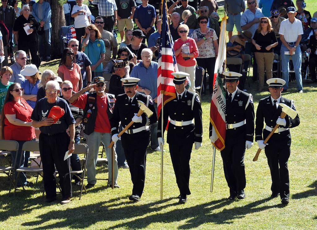 Description of . Members of Redlands Fire Department Color Guard brings the flag forward during the Veterans Day cermony at Jennie Davis Park in Redlands, Monday, Nov. 11, 2013. (John Valenzuela/Staff Photographer)