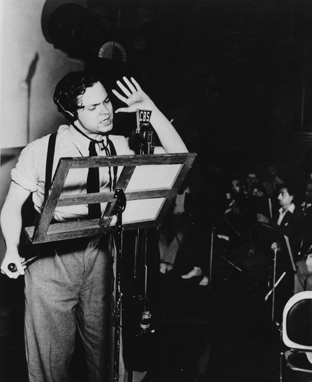 Description of . Orson Welles broadcasts his radio show of H.G. Wells' science fiction novel