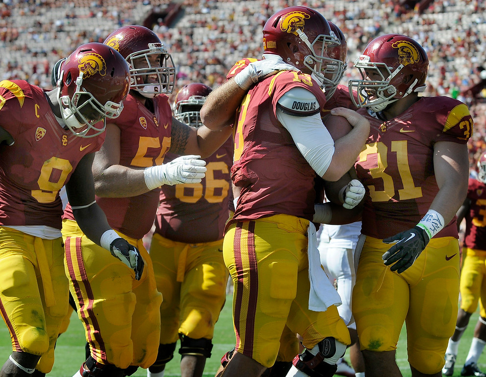 Description of . Second string QB Max Wittek is congratulated on his 4th quarter TD. USC defeated Boston College 35-7 in a game played at the Coliseum in Los Angeles, CA. 9/14/2013. photo by (John McCoy/Los Angeles Daily News)