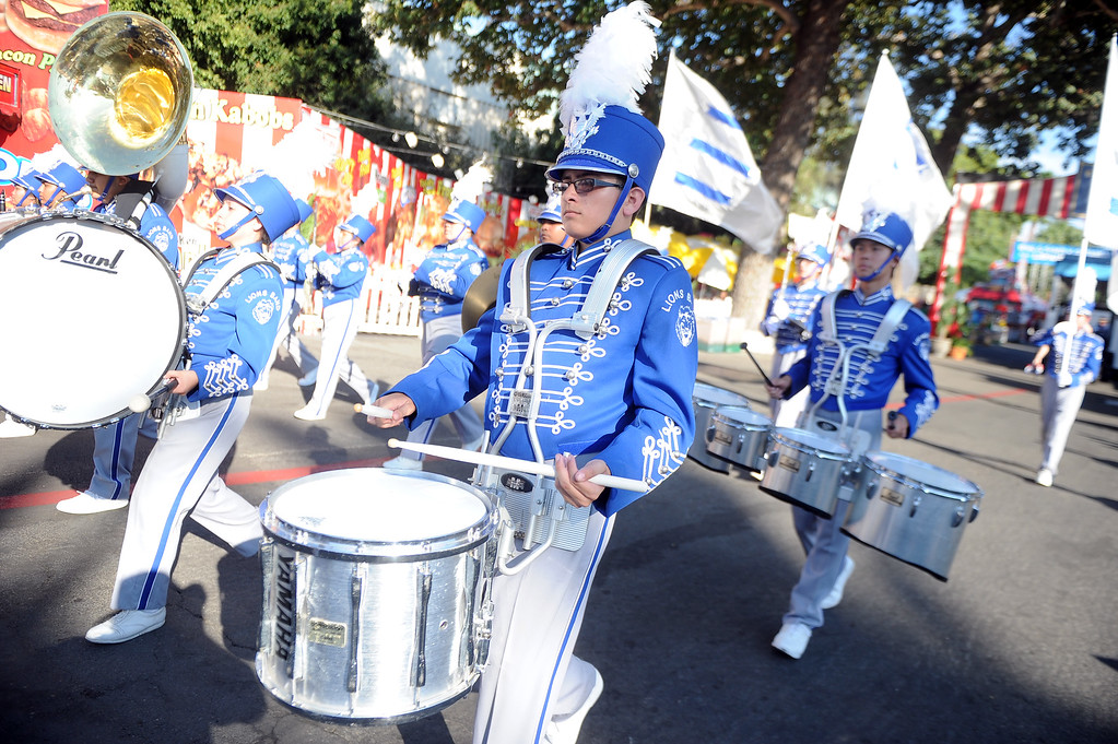 Description of . The El Monte High School band performs during the Diamond Bar community parade during the 91st Annual L.A. County Fair in Pomona, Calif. on Thursday, Sept. 5, 2013.   (Photo by Keith Birmingham/Pasadena Star-News)