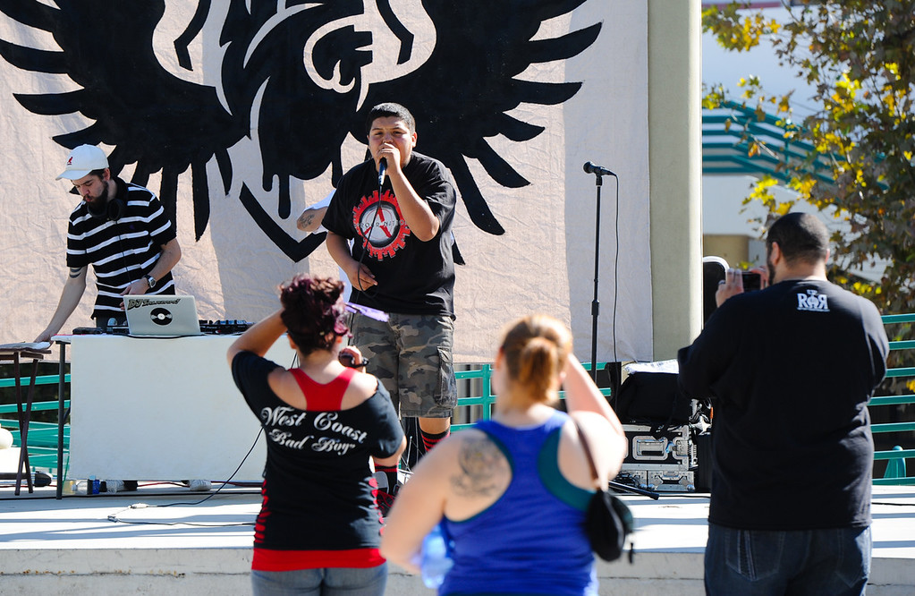Description of . San Bernardino rapper David Vara, 15, perfoms at the Turn Up the Vote event at Court Street Square in San Bernardino on Sunday, Oct. 20, 2013. Zealous Creative and San Bernardino Generation Now hosted the event in effort to encourage young adults to participate in the November 5 election. (Rachel Luna / San Bernardino Sun)