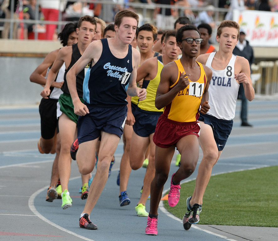 Description of . Crescenta Valley's Gabe Collison, left, competes in the division  1 3200 race during the CIF Southern Section track and final Championships at Cerritos College in Norwalk, Calif., Saturday, May 24, 2014. 