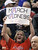 An Arizona fan holds up a March madness sign during a second-round game against Belmont in the NCAA college basketball tournament in Salt Lake City Thursday, March 21, 2013. (AP Photo/Rick Bowmer)