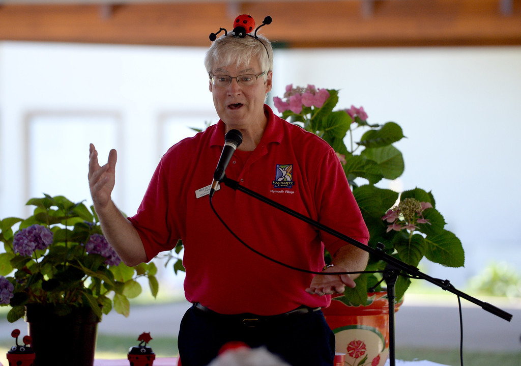Description of . Chaplain Mike Ballinger entertains the crowd during the 4th annual Grove Ladybug Release party at Plymouth Village in Redlands, Ca., Thursday, June 12, 2014. The Grove at Plymouth Village in Redlands, held its annual Ladybug Release party, letting thousands of the beetles go at the senior living retirement community. (Photos by John Valenzuela/ Redlands Daily Facts)