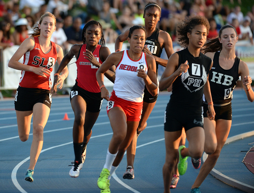 Description of . Etiwanda's Jacquelyn Hill, left, and Redondo's Amber Gore, (8) competes in the 800 meter race during the CIF California State Track & Field Championships at Veteran's Memorial Stadium on the campus of Buchanan High School in Clovis, Calif., on Saturday, June 7, 2014. 