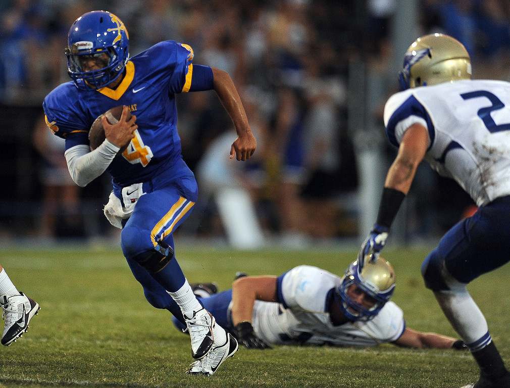 Description of . Bishop Amat quarterback Koa Haynes (C) (4) runs for a first down against Santa Margarita in the first half of a prep football game at Bishop Amat High School on Friday, Aug. 30, 2013 in La Puente, Calif.   (Keith Birmingham/Pasadena Star-News)