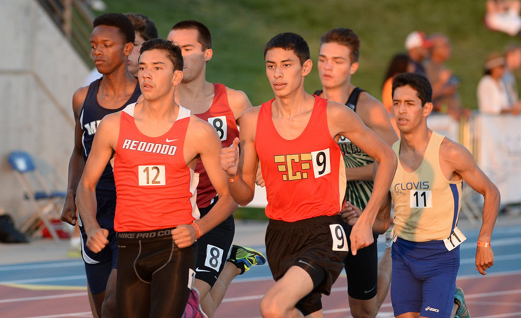 Description of . Harvard Westlakes' David Manahan (8) an=long with Redondo's Sergio Rodriguez competes in the 800 meter race during the CIF California State Track & Field Championships at Veteran's Memorial Stadium on the campus of Buchanan High School in Clovis, Calif., on Saturday, June 7, 2014. 