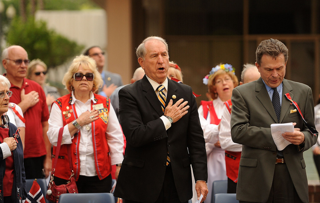 Description of . Mayor Pat Morris joins members of the Sons of Norway to sing the United States National Anthem  during a Norway Constitution Day celebration in downtown San Bernardino May 17, 2013.  GABRIEL LUIS ACOSTA/STAFF PHOTOGRAPHER.