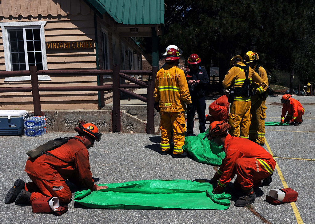 Description of . Firefighters from around the San Bernardino valley and mountains are participating in the 27th annual wildland training exercises in Cedar Glen. During this annual event, local firefighters train together in a realistic environment, sharpening their skills, in preparation for the upcoming high fire hazard months of summer and fall, CalFire officials said in a press release. Firefighters across Southern California already have had to battle several recent blazes in dry and windy conditions.LaFonzo Carter/ Staff Photographer