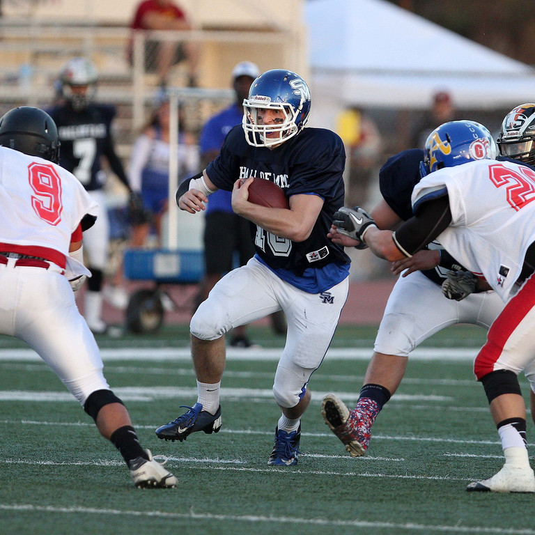Description of . San Marino's Andrew Ferraco (18) runs for yardge during the 35th Annual Hall of Fame All-Star Football Game at West Covina High School in West Covina, CA on Friday, May 16, 2014. (SVGN/Correspondent Photo by David Thomas/SPORTS)
