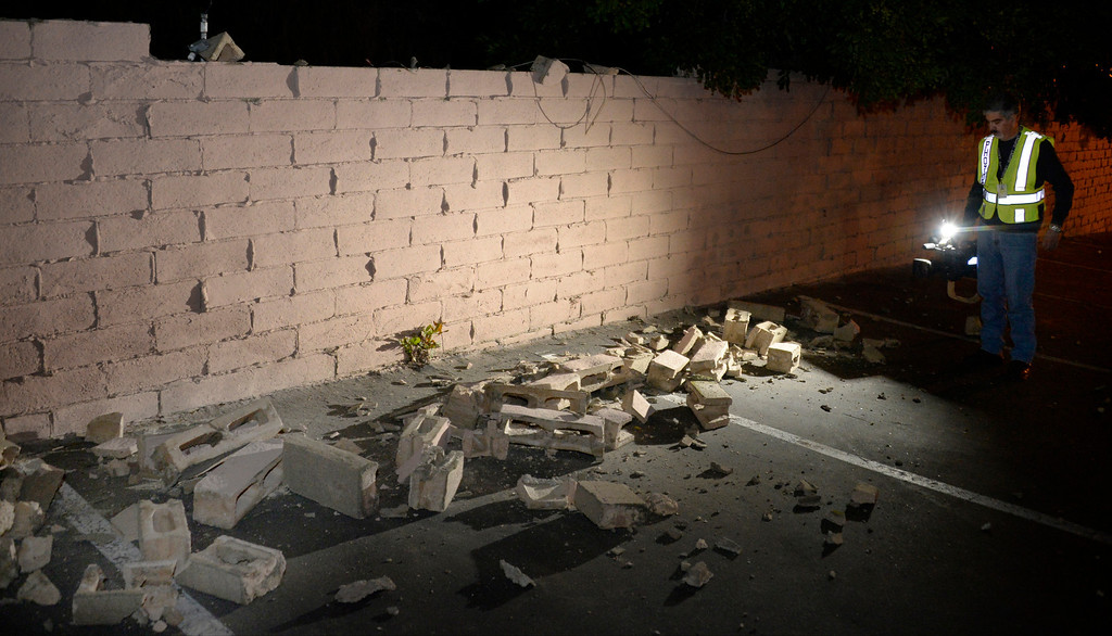 Description of . TV news camera man Juan Guerra shoots video of damaged brick walls after an earthquake with a magnitude of 5.1 struck near La Habra on Friday night, following an earlier 3.6 quake in the same area. The bigger quake was originally reported as magnitude 5.4 and struck at 9:09 p.m. PT. The first temblor hit about an hour before that. Caltech seismologists said the 5.1 quake was followed by at least 30 aftershocks, two greater than magnitude 3.0. Fullerton, California, March 29,2013 Photo by Gene Blevins/LA Daily News