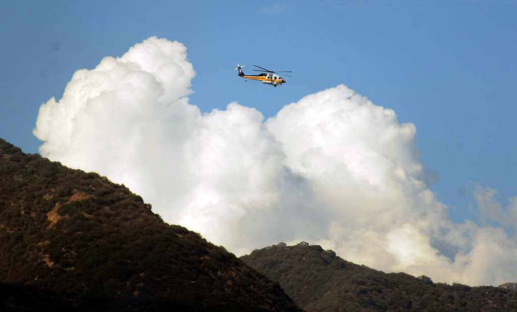 Description of . Los Angeles County Firefirghters with aid of water dropping helicopters battle a five acre brush fire in the San Gabriel Mountains above Azusa just above the former Shooting range on Tuesday, Aug. 27, 2013 in Azusa, Calif.   (Keith Birmingham/Pasadena Star-News)