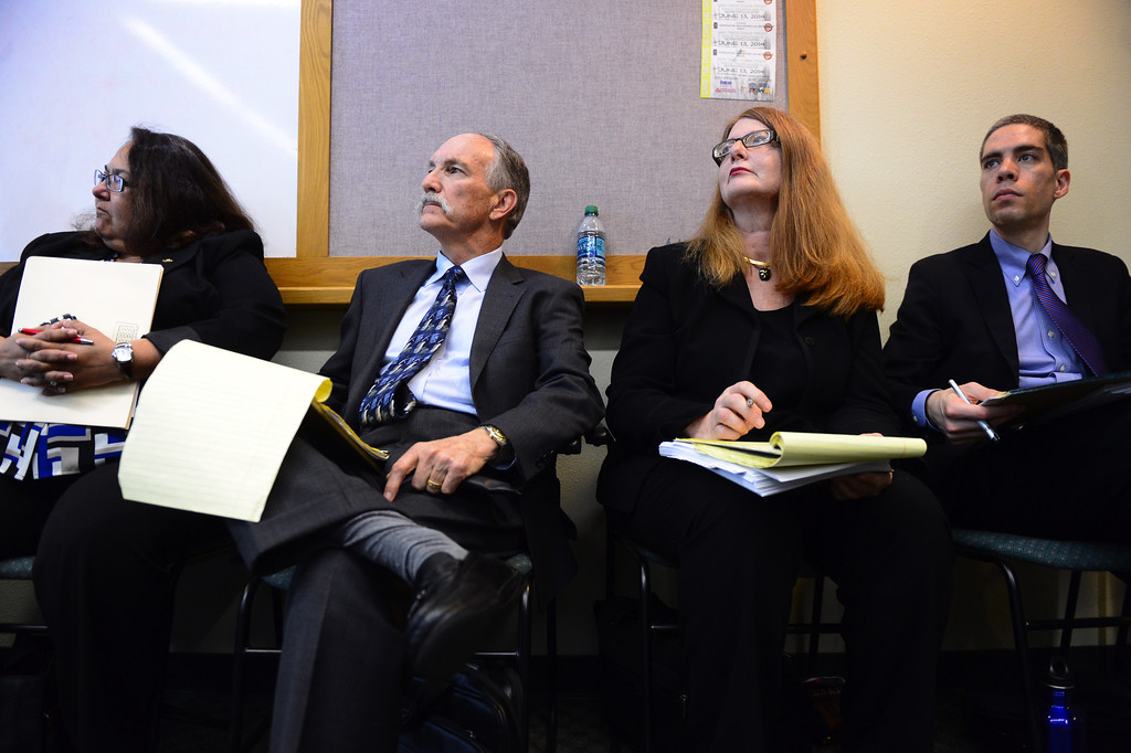 Description of . Sierra Madre officials Elaine Aguilar, geologist Richard Slade, Teresa Highsmith and Len Aslanian listen to their asst. city attorney present their case against Arcadia in a water dispute before the Raymond Basin Management Board Thursday, March 13, 2014. Sierra Madre accuses Arcadia of stealing water out of their aquifer in the eastern unit of the Raymond Basin. The well in dispute is Arcadia's Anoakia Well.  (Photo by Sarah Reingewirtz/Pasadena Star-News)