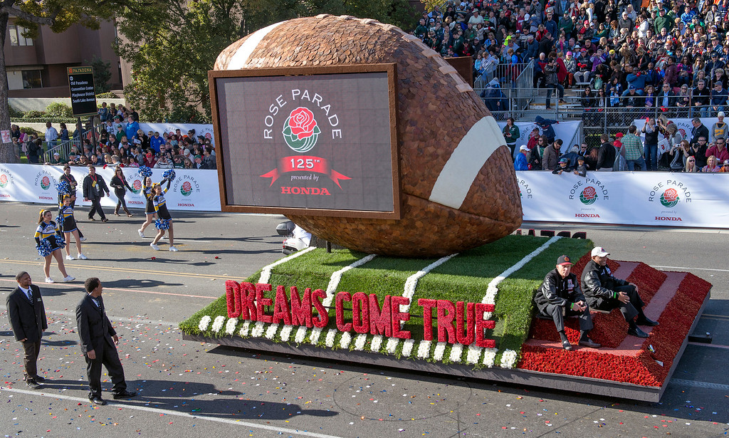 Description of . Parade Closing Program float in commemoration of the 100th Rose Bowl game during 2014 Rose Parade in Pasadena, Calif. on January 1, 2014. (Staff photo by Leo Jarzomb/ Pasadena Star-News)