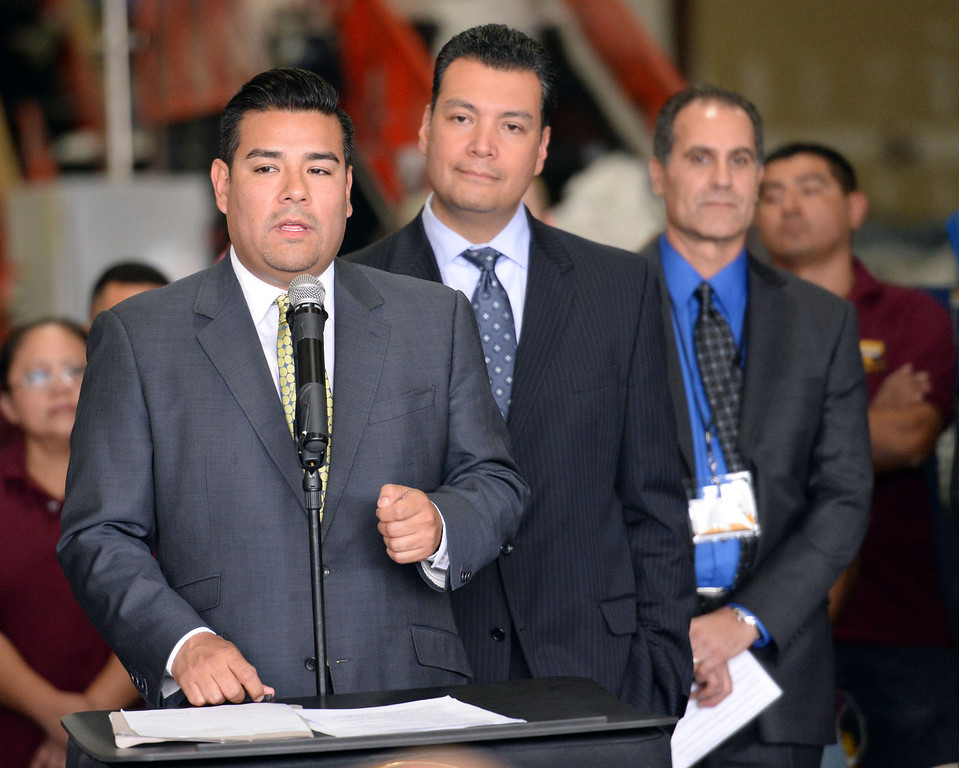 Description of . Senator Ricardo Lara, left, D-Huntington Park/ Long Beach speaks as Sen. Alex Padilla, D-Pacoima looks on as they announce the support for legislation to ban single use plastic bags during a press conference at Command Packaging in Vernon, Calif., on Friday, Jan. 24, 2014. (Keith Birmingham Pasadena Star-News)