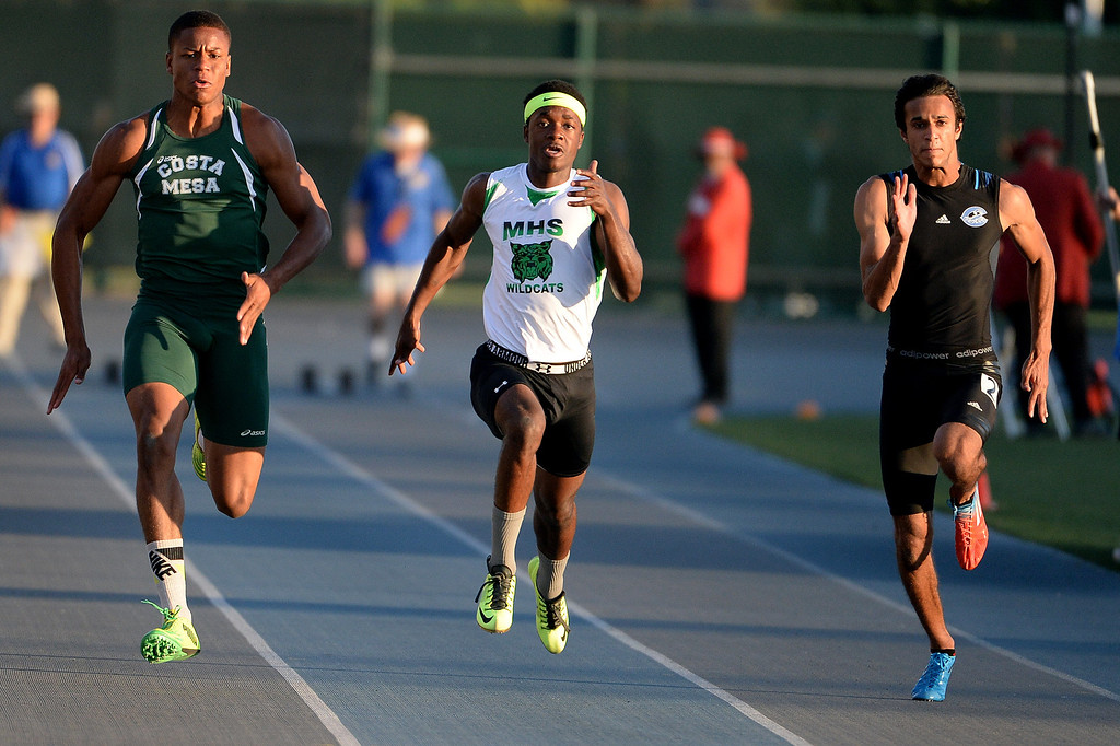 Description of . Costa Mesa's Quinton Bell, left, Monrovia's Cravon Gillespie, center, Camarillo's Ahmed Obed, right, competes in the 100 meter dash during the CIF-SS Masters Track and Field meet at Falcon Field on the campus of Cerritos College in Norwalk, Calif., on Friday, May 30, 2014.   (Keith Birmingham/Pasadena Star-News)