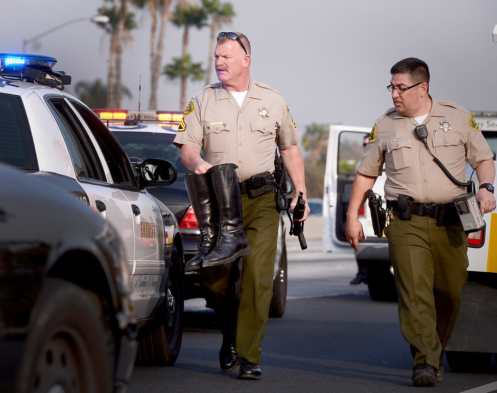 Description of . Los Angeles County Sheriff deputies carry a deputies possessions after being injured in an accident with a SUV east of Puente Avenue on the eastbound 10 Freeway in Baldwin Park Thursday, January 23, 2014. The deputy was injured. (Photo by Sarah Reingewirtz/Pasadena Star-News)