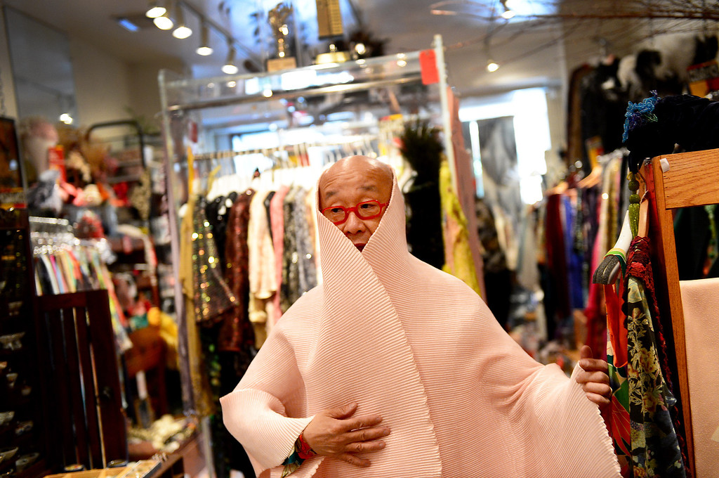 Description of . Designer Peter Lai shows off a shawl he designed Thursday, June 20, 2013 at his San Marino boutique. Lai is retiring and closing his boutique after 20 years in San Marino. In retirement he plans to continue to perform Kabuki and open a Japanese village in downtown Los Angeles. (SGVN/Staff Photo by Sarah Reingewirtz)