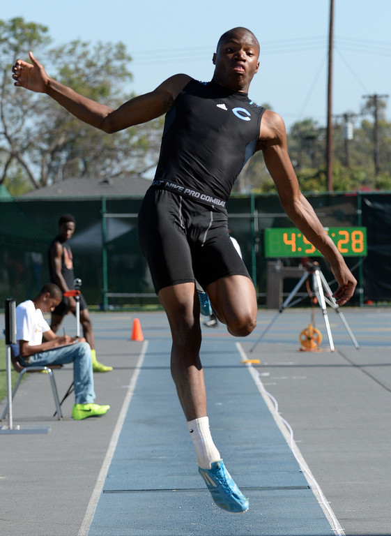 Description of . Camarillo's Justin Warren competes in the long jump during the CIF-SS Masters Track and Field meet at Falcon Field on the campus of Cerritos College in Norwalk, Calif., on Friday, May 30, 2014.   (Keith Birmingham/Pasadena Star-News)