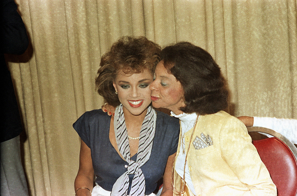 Description of . Helen Williams, Vanessa William's mother, kisses her daughter after she resigned as Miss America during a press conference at the Sheraton Center on July 23, 1984. She resigned her title because sexually explicit photos of herself were published in Penthouse Magazine. (AP Photo)