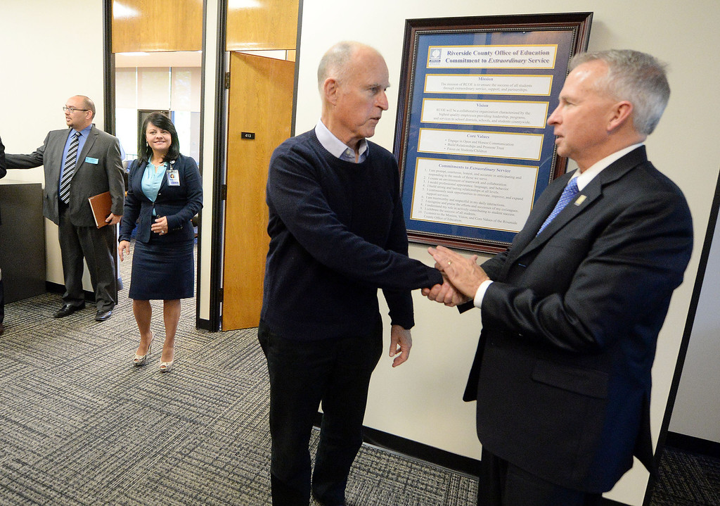 Description of . California Governor Jerry Brown greets Riverside County Superintendent of Schools Kenneth Young Tuesday January 14, 2014 at the Riverside County Office of Education. (Will Lester/Inland Valley Daily Bulletin)