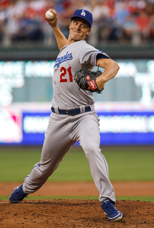 Description of . Los Angeles Dodgers starting pitcher Zack Greinke throws during the second inning of a baseball game against the Philadelphia Phillies, Friday, Aug. 16, 2013, in Philadelphia. (AP Photo/Christopher Szagola)
