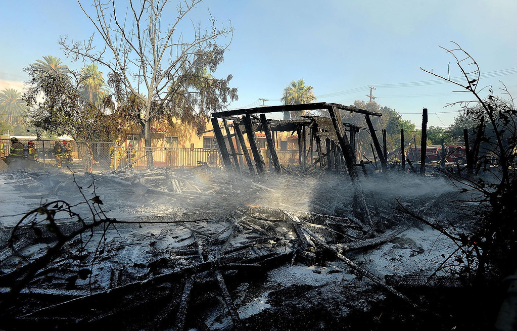 Description of . A vacant home lies destroyed by a four-alarm fire along the 700 block of Seventh Street in San Bernardino August 18, 2013. GABRIEL LUIS ACOSTA/STAFF PHOTOGRAPHER.