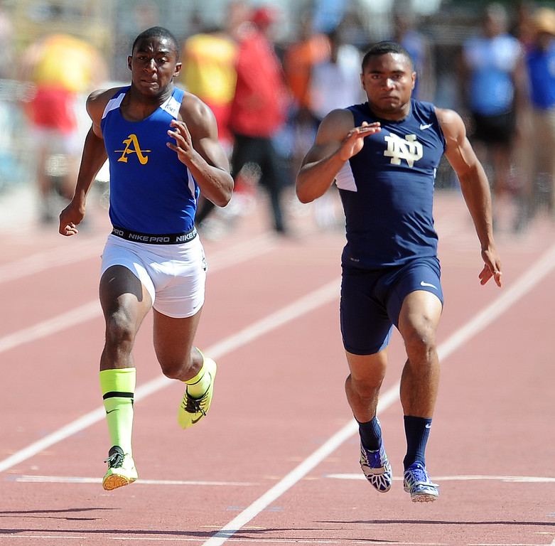 Description of . Bishop Amat's Darren Andrews finished second behind Notre Dame's Khalfani Muhammad in the 100 meters race during the CIF-SS track & Field championship finals in Hilmer Stadium on the campus of Mt. San Antonio College on Saturday, May 18, 2013 in Walnut, Calif.  (Keith Birmingham Pasadena Star-News)