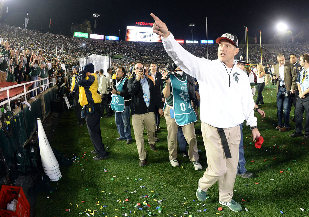Description of . Michigan State head coach Mark Dantonio points towards the stands after defeating Stanford 24-20 during the 100th Rose bowl game in Pasadena, Calif., on Wednesday, Jan.1, 2014. 