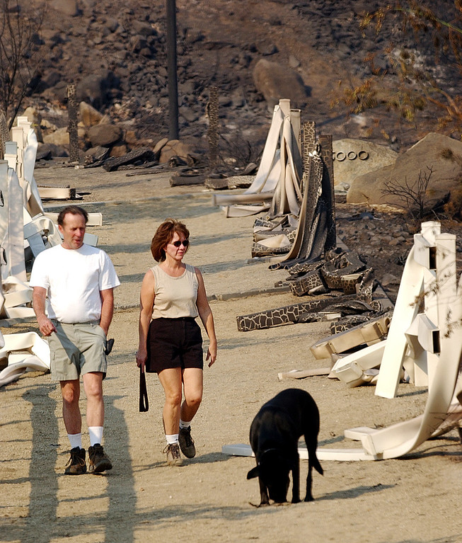 Description of . The GrandPrix fire started three days before the Old Fire.  It fed into the Old Fire. Ten years later, there are rumblings that it too was started by an arsonist. But to this day, its origins remain a mystery. Henry and Lisa Harris walk their dog