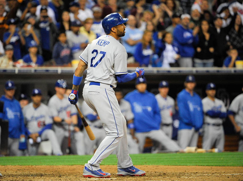 Description of . Matt Kemp #27 of the Los Angeles Dodgers strikes out for the final out during the ninth inning of a baseball game against the San Diego Padres at Petco Park on September 20, 2013 in San Diego, California. The Padres won 2-0.  (Photo by Denis Poroy/Getty Images)