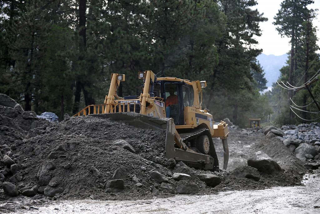 Description of . Clean up continues after Sunday's storm caused flooding on Monday, August 4, 2014 in Forest Falls, Ca. (Micah Escamilla/San Bernardino Sun)